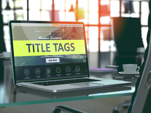 Title Tags Concept on Laptop Screen.